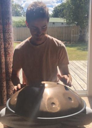 Aaron playing the Handpan